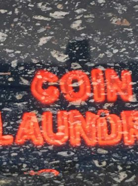 Coin Laundry Neon Sign on Asphalt