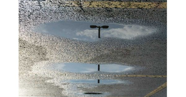 Light Pole in Puddles